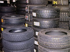 Tyres being stored in a warehouse (http://www.bbc.co.uk/schools/gcsebitesize/business/images/stock.jpg)