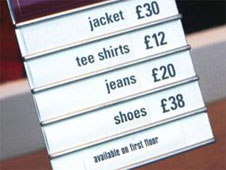 A sign showing clothes prices in a shop window - jacket £30, tee shirt £12, jeans £20 and shoes £38 (http://www.bbc.co.uk/schools/gcsebitesize/business/images/prices.jpg)