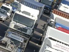 Lorries on the motorway (http://www.bbc.co.uk/schools/gcsebitesize/business/images/transport2.jpg)