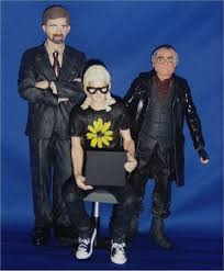See full size image (http://tbn1.google.com/images?q=tbn:aZz1hyfePhiE3M:http://www.joeacevedo.com/images/customzone/customcon/figurechick2008/lone-gunmen.jpg)