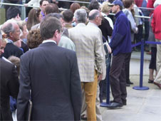 people queueing along a street (http://www.bbc.co.uk/schools/gcsebitesize/business/images/queues.jpg)
