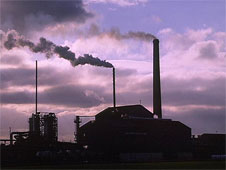 A factory with chimneys releasing pollution into the atmosphere (http://www.bbc.co.uk/schools/gcsebitesize/business/images/pollution.jpg)