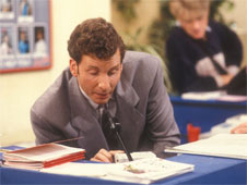 Still from sitcom 'The Brittas Empire'. Gordon Brittas speaks to his staff using an overhead speaker system. (http://www.bbc.co.uk/schools/gcsebitesize/business/images/internal_comms.jpg)