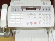fax machine (http://www.bbc.co.uk/schools/gcsebitesize/business/images/fax_machine.jpg)