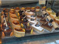 A selection of decorated cakes on a shop shelf (http://www.bbc.co.uk/schools/gcsebitesize/business/images/cakes_quality.jpg)
