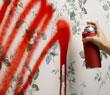 hand spraying red paint on wallpaper (http://www.bbc.co.uk/schools/gcsebitesize/design/images/gr_spray_paint.jpg)