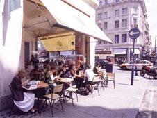 People sit outside in a street cafe in central London (http://www.bbc.co.uk/schools/gcsebitesize/business/images/cafe.jpg)