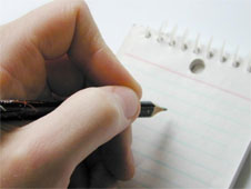 A close up of someone about to write on a pad of paper with a pencil (http://www.bbc.co.uk/schools/gcsebitesize/business/images/planning.jpg)