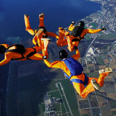sky divers in freefall under gravity (http://www.bbc.co.uk/schools/gcsebitesize/science/images/energy_gravity.jpg)