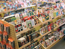 A shelf of different magazines on display in a shop (http://www.bbc.co.uk/schools/gcsebitesize/business/images/magazines.jpg)