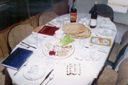 Table with seder meal and Haggadah by every place (http://www.bbc.co.uk/religion/religions/judaism/holydays/images/passovertable.jpg)