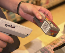 A cashier scanning a barcode (http://www.bbc.co.uk/schools/gcsebitesize/ict/images/barcode.jpg)
