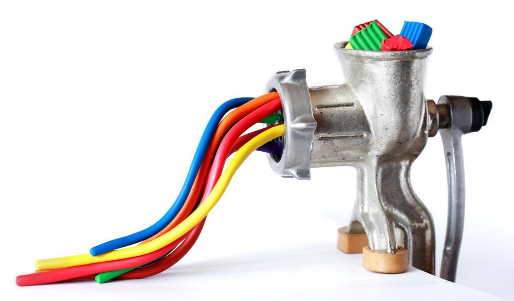 (http://images.wisegeek.com/grinder-extruding-clay.jpg)