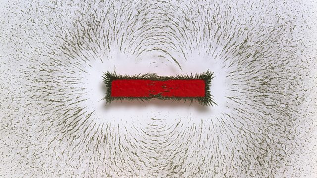 Iron filings showing the magnetic field of a bar magnet. (http://ichef.bbci.co.uk/images/ic/640xn/p01ght9s.jpg)