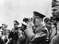 Hitler looking through binoculars (http://www.bbc.co.uk/schools/gcsebitesize/history/images/hist_invading_poland.jpg)